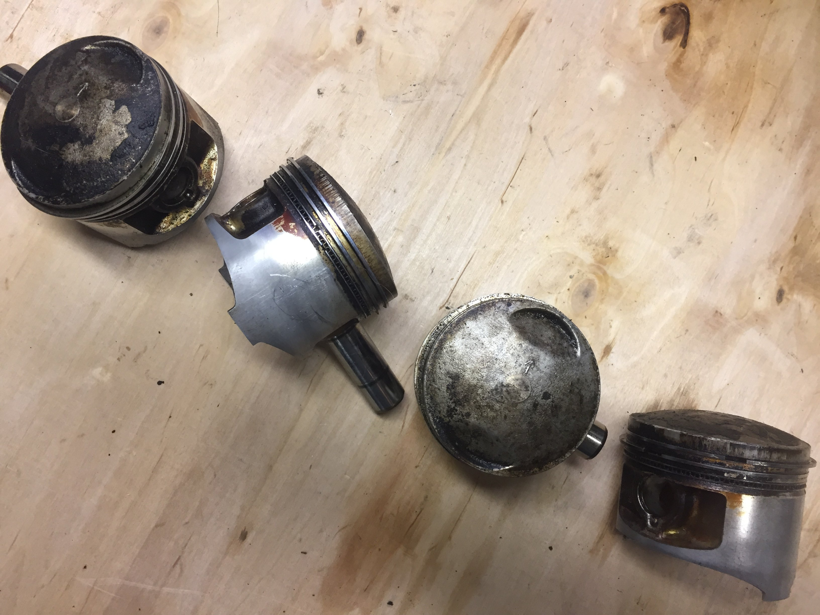 Dirty Motorcycle Pistons